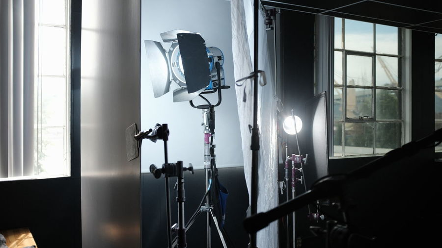 ARRI Absence Behind The Scenes Business Camera - Photographic Equipment Day Electric Lamp Group Hmi Illuminated Indoors  Lighting Equipment Modern No People Photo Shoot Photographic Equipment Photography Themes Studio Technology Tripod Window