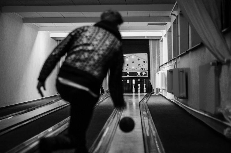Hit em Adult Bowling Day Full Length Indoors  Kegel Leisure Activity Lifestyles Men One Person People Real People Rear View Walking Women