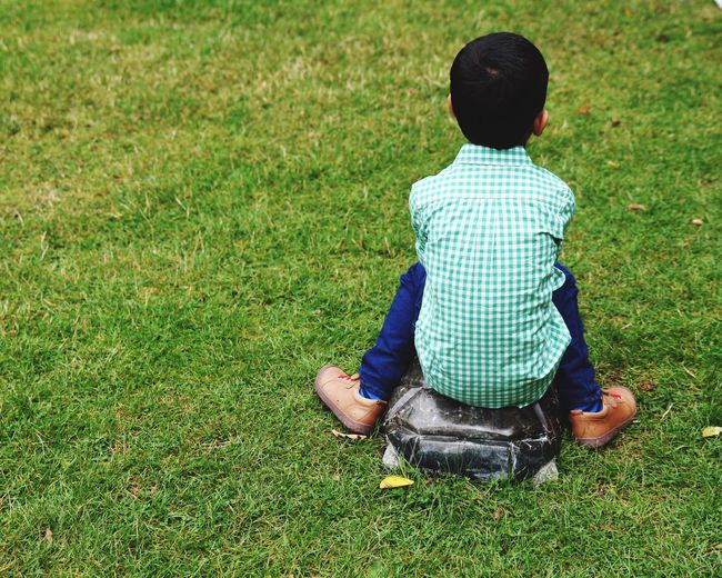 Upset child. Naughty Corner Argument Upset Grass Real People Childhood Sitting Rear View Field Boys Casual Clothing Park - Man Made Space Leisure Activity Day Outdoors Nature Child