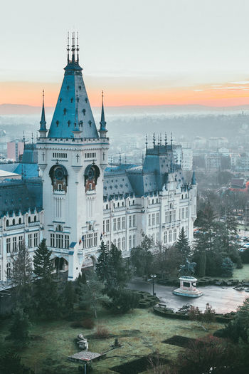 Panoramic sunset view on golden hour over Palace of Culture, Iasi, Romania Iasi Palatul Culturii Panoramic Sunset Collection Travel Architecture Building Exterior Built Structure City Cityscape Day Golden Hour Heritage High Angle View Landmark No People Outdoors Palace Of Culture Sky Sunset Tourism Transportation Travel Destinations Tree Water