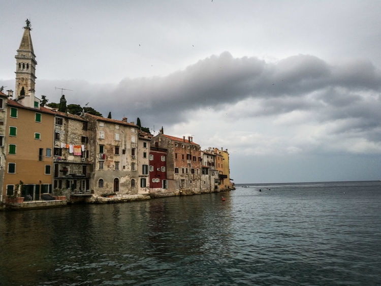 Dramatic Water Building Exterior Architecture Cloud - Sky Sea Built Structure House Residential Building Horizon Over Water Storm Cloud Storm EyeEm Diversity Natgeotravelpic Natgeotravel Natgeo Tourism Vacations Travel Destinations Croatiafullofnature Croatiafulloflife Croatiafulofcolours Rovinj Visitcroatia No People Rain