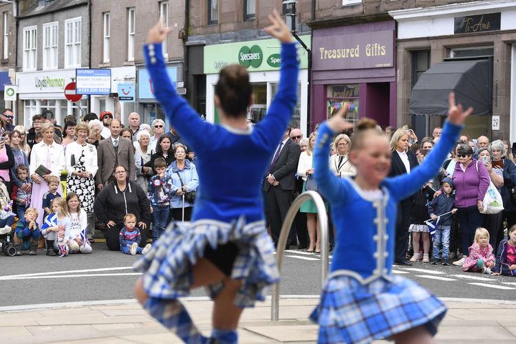People dancing on street in city