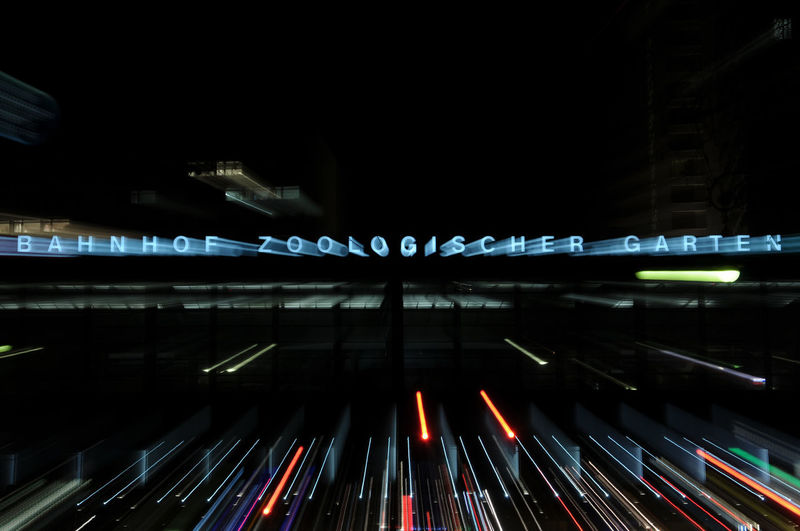 Motion blurred neon lights of Bahnhof Zoologischer Garten in West Berlin ©alexander h. schulz Bahnhof Zoologischer Garten Berlin Charlottenburg  Letters Night Lights Nightphotography Station Zoo Zoologischer Garten Berlin Black Blur Blurred Motion Color Famous Place Iconic Illuminated Lettering Long Exposure Motion Zoom Neon Neon Lights Night No People Outdoors West Berlin