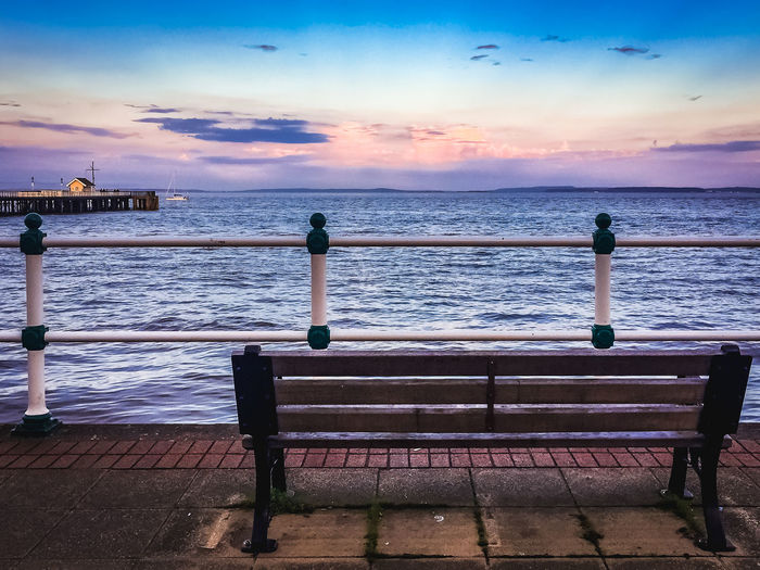 Bench Bench Seat Beach Beauty In Nature Blue Cloud - Sky Clouds And Sky Day Horizon Over Water No People Outdoors Railing Sea Seaside Sky Sunset Tranquil Scene Tranquility Water