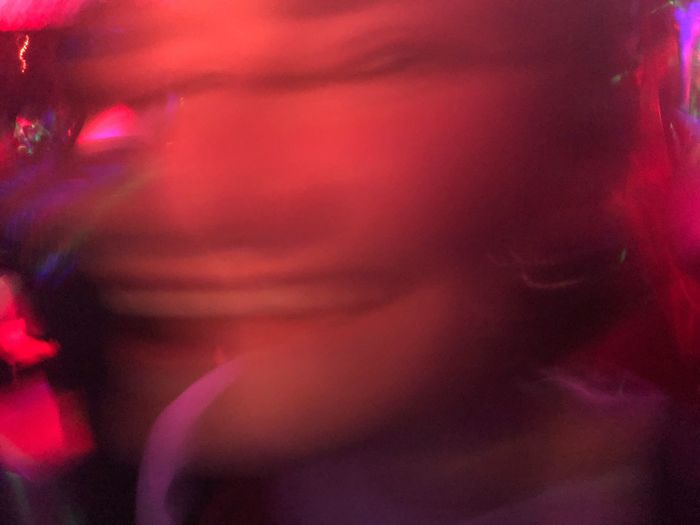 Young woman smiling on the dance floor with a slight distortion... maybe I had too many drink when I took this pic hmm Whaaaat  Funny Faces Funny Distorted Faces Distorted Image Distorted Distortion Pink Color Abstract Multi Colored Close-up Full Frame Backgrounds Indoors  Red Night