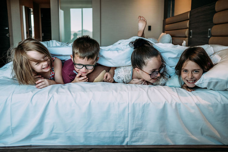 Group of people on bed at home