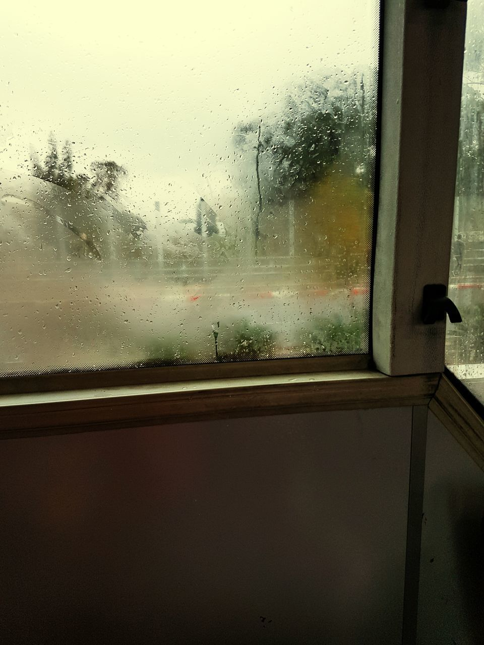 window, glass - material, transparent, wet, weather, looking through window, rain, glass, indoors, drop, water, condensation, raindrop, no people, day, close-up, sky, transportation, nature, tree