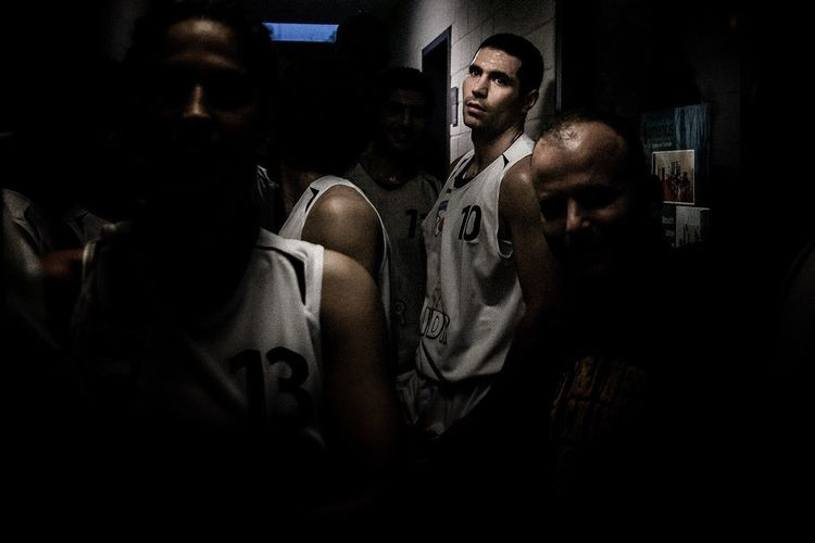 """Basketball star Michael Madanly's gaze ambles pensively towards my lens. With houses tumbling down into large piles of dust the 16 members of Germanys' first refugee basketball team """"Souriana"""" had to leave their beloved Syria behind and venture into a land they have only heard by name. Madanly is also a refugee, His brother was held captive and tortured by militia until he paid the ransom. On the Eve of the arab Spring in 2011, his Family decided to leave syria and spread all over the world: California, Amsterdam, with Michael continuing his career as a professional basketball player in China, Hongkong and Libanon. The Photojournalist - 2016 EyeEm Awards The Photojournalist – 2016 EyeEm Awards The Portraitist - 2016 EyeEm Awards Syrian Refugees Refugeeswelcome Basketball Portrait The Photojournalist 2016 Finalists"""