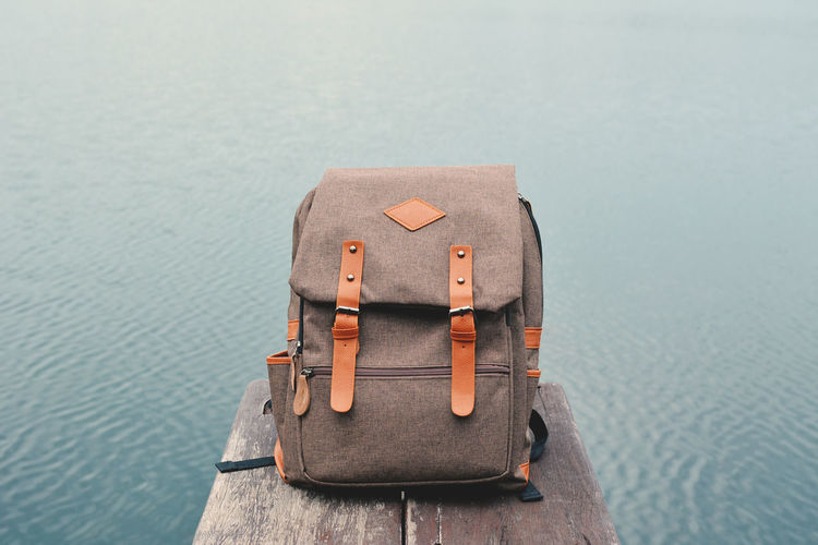 Close-Up Of Backpack Against Sea