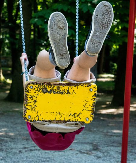 Paint The Town Yellow Swinging Childhood Close-up Day Hanging Human Body Part Human Leg Lifestyles Low Section Men One Person Outdoors Park - Man Made Space Park Swing People Real People Shoe Swing Wearing Yellow