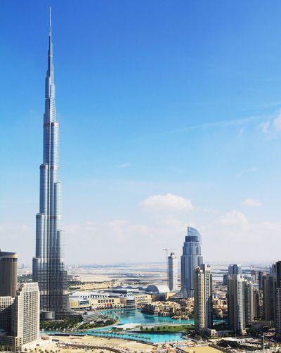 Modern Cityscape Against Blue Sky