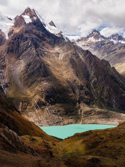 Huayhuash Trekking Cordillera Blanca Andes Mountain Scenics - Nature Mountain Range Beauty In Nature Tranquil Scene Cloud - Sky Tranquility Environment Sky Nature Non-urban Scene Landscape Day No People Idyllic Rock Travel Destinations Remote Water Geology Outdoors Mountain Peak Formation Snowcapped Mountain