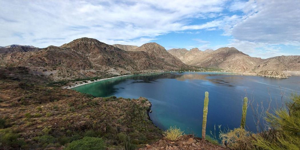 el coyote Travel Destinations Sea Lake Landscape_Collection Cactus Landscape_photography Cactus Garden Clouds Mountain Landscape Rock - Object Geology Outdoors Scenics Nature Travel Water Physical Geography Mountain Range Travel Destinations Panoramic Beauty In Nature High Angle View Sky Day