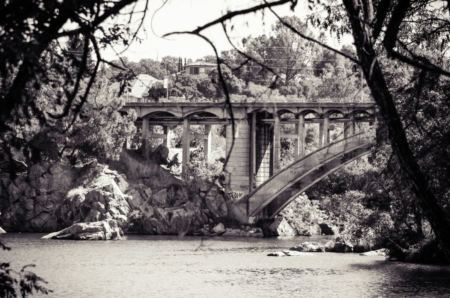 """""""Down by the River"""" - Took a stroll along the American River behind the old Folsom Powerhouse recently and captured this shot of the Rainbow Bridge. California Blackandwhite Black & White Bridge Bridges Graffiti River Rainbow Bridge Folsom American River"""
