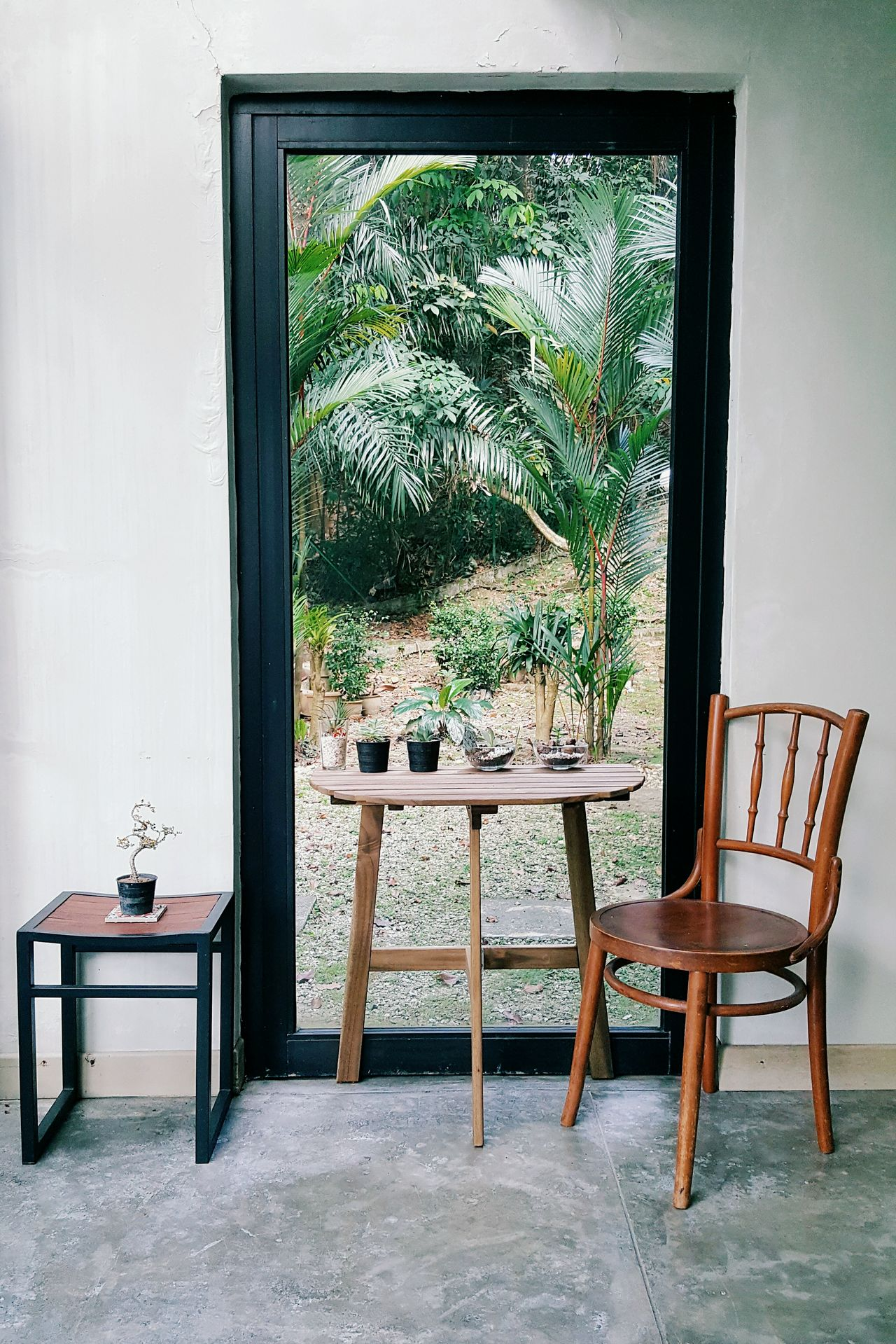 Chair and table by glass door at home