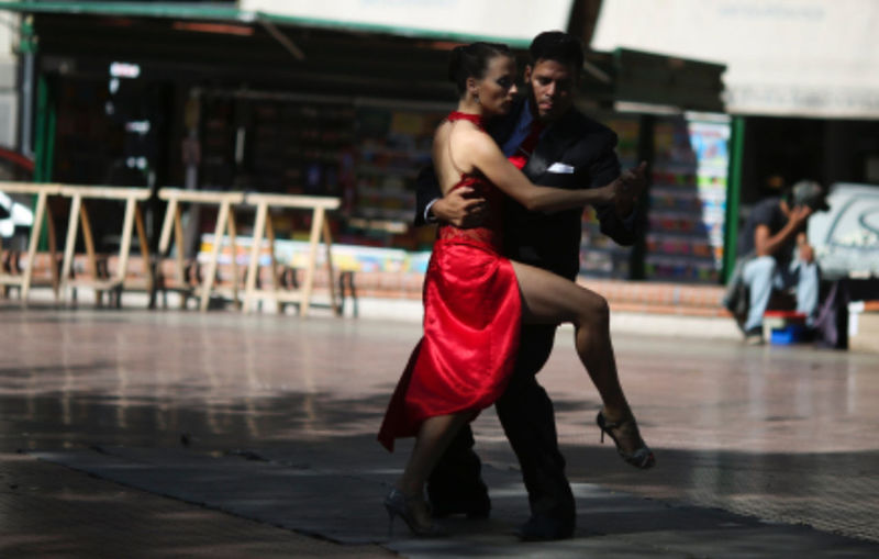 Adult Dancing Focus On Foreground Full Length Incidental People Leisure Activity Lifestyles Men Motion People Performance Real People Red Side View Sport Standing Tango Dancers Togetherness Two People Women Young Adult