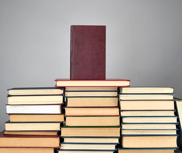 Book Publication Stack Learning Education Indoors  Large Group Of Objects Hardcover Book Textbook Wisdom Literature People Intelligence Gray Background Studio Shot Gray Abundance Still Life Expertise Studying