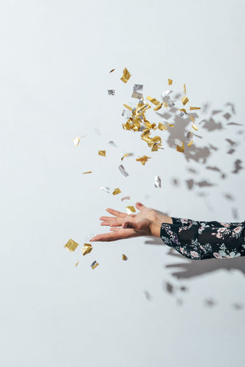 Birthday Celebration Close-up Confetti Copy Space EyeEm Best Edits Girl, Gold Colored Gray Background Hands Human Hand Lifestyle New Year One Person Party Party Time People Studio Shot Throwing  White Background Market Bestsellers 2017