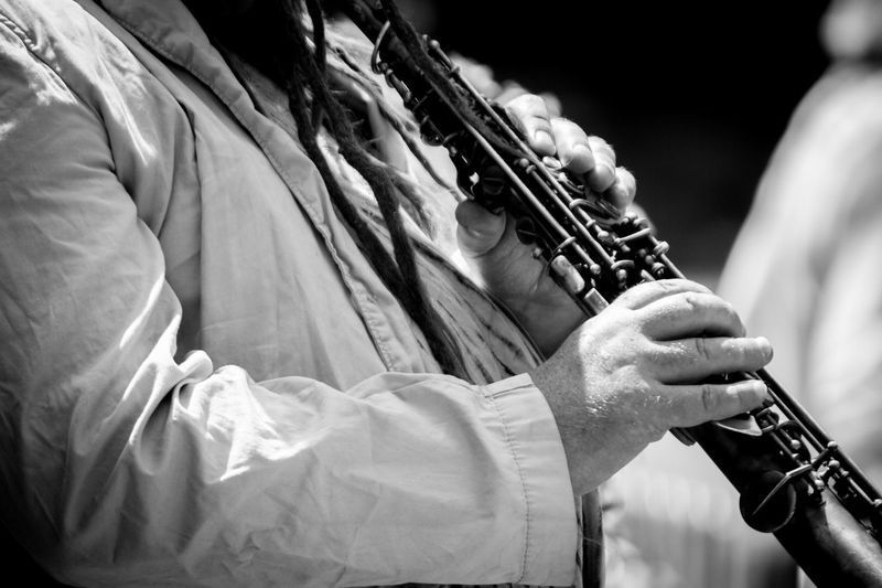 Close-up of man playing clarinet