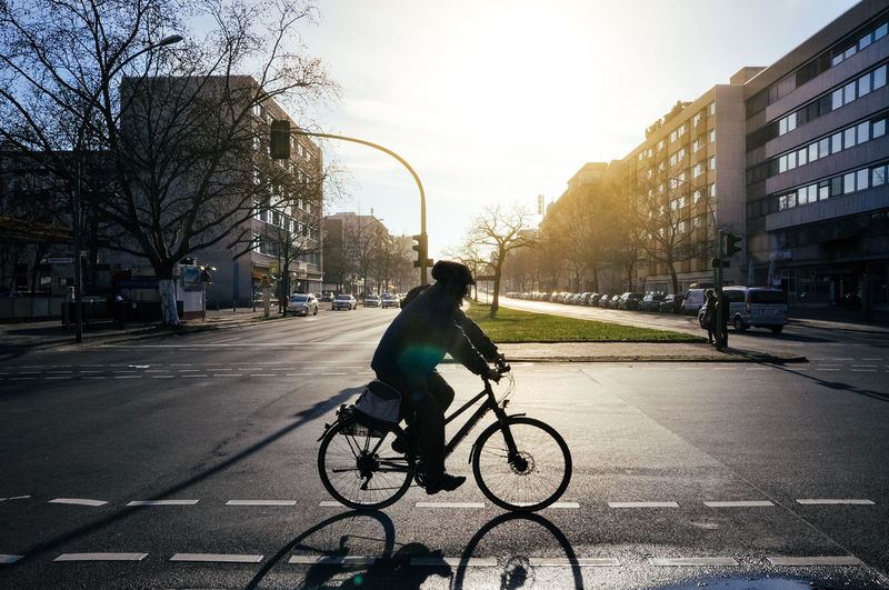 Adult Adults Only Berlin Bicycle Business City City Life City Street Commuter Cycling Males  Men Mode Of Transport One Man Only One Person Only Men Outdoors People Riding Road Street Sunset Transportation Urban Road The City Light