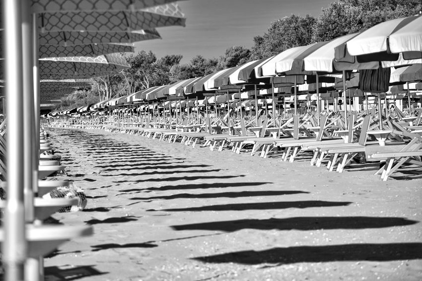 Beach Sand Chair Beachphotography Blackandwhite Summer Sunset City Sky Architecture Building Exterior Built Structure Sandy Beach Sun Lounger Hooded Beach Chair Deck Chair Parasol Lounge Chair Outdoor Cafe