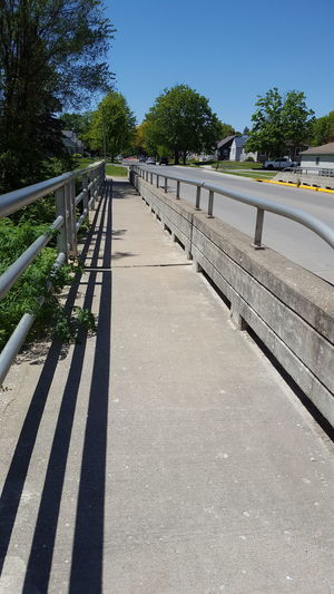 Railing Tree Shadow Outdoors Day Sunlight Summer Sky Clear Sky Nature No People Water Tree Rural Scene Blue Street Nature Grass The Great Outdoors - 2017 EyeEm Awards Bridge - Man Made Structure Sunlight Architecture Cloud - Sky Agriculture Built Structure Live For The Story
