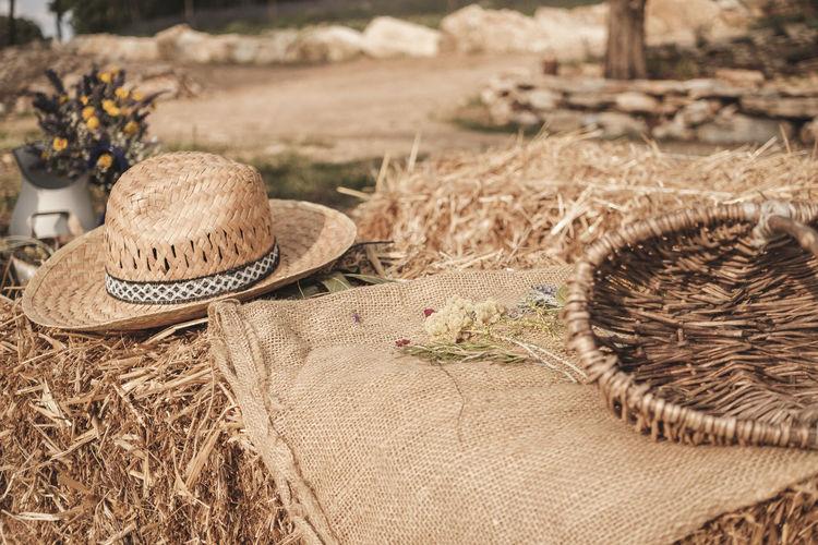 Close-up of hat on wicker basket on field