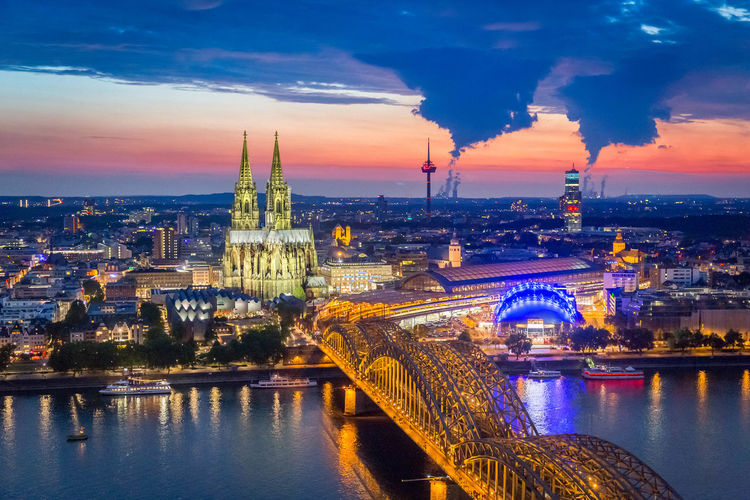 The creation of the clouds Architecture Bridge - Man Made Structure Building Exterior Built Structure City Cityscape Cityscape Cloud Clouds And Sky Cologne Cologne Cathedral Connection Famous Place Germany Illuminated Köln Light River Sky Sunset Sunset_collection Tourism Tower Travel Travel Destinations