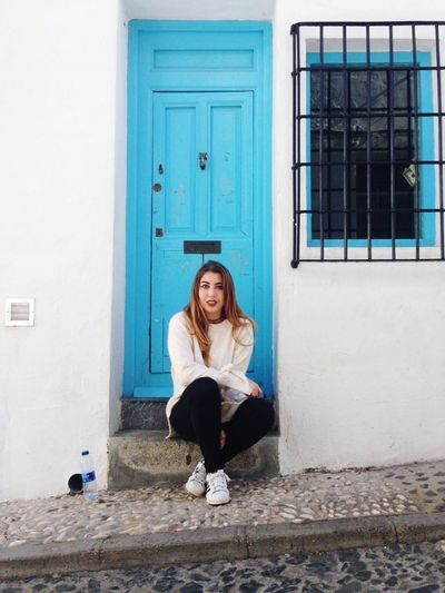 Blond Hair Young Women Full Length Portrait Sitting City Long Hair Door Building Exterior Doorway Closed Door
