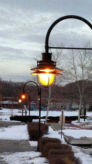 Street light against sky