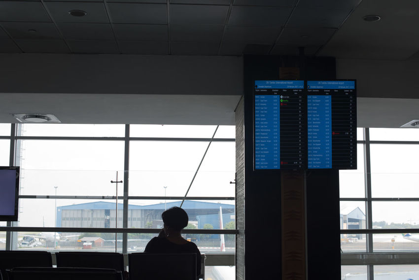 Departure Adult Airport Airport Departure Area Arrival Departure Board Day Indoors  Journey Modern One Person Real People Transportation Travel