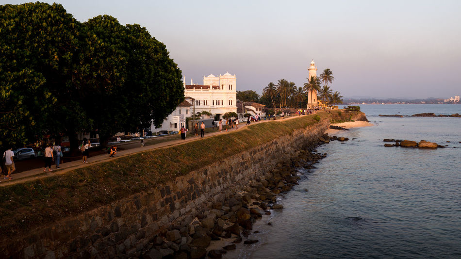 Lighthouse of Galle Fort at sunset, Sri Lanka Architecture City Famous Place Galle Galle Fort History Holiday Lighthouse Monument Ocean Old Outdoors Sightseeing Sri Lanka Sunset Tourism Tourist Tourist Attraction  Travel Travel Travel Destinations Vacations