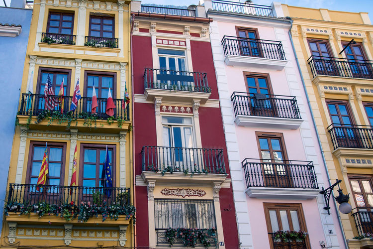 colorful town buildings spain Building Exterior Architecture Built Structure Window Building Residential District No People Low Angle View Day Balcony City Full Frame Railing Backgrounds Outdoors Glass - Material Nature Side By Side Apartment Entrance