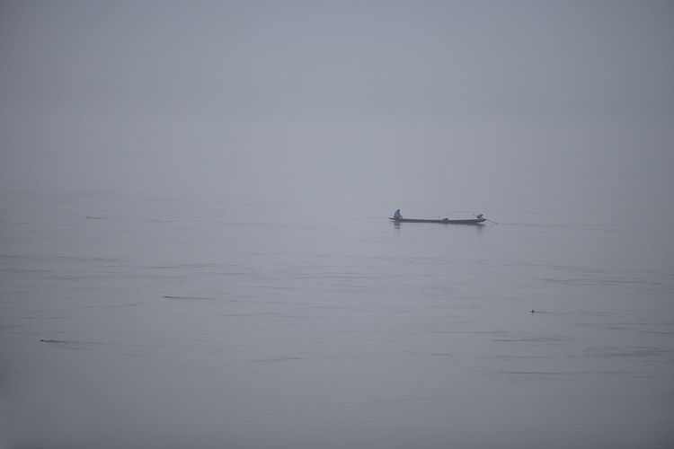 Hong River, Chiang Khan, Loei province, Thailand. Beauty In Nature Chiang Khan Foggy Morning Khong River Loei Loei,thailand Morning Nature Nautical Vessel Outdoors River Rowing Scenics Silhouette South East Asia Tranquility Water