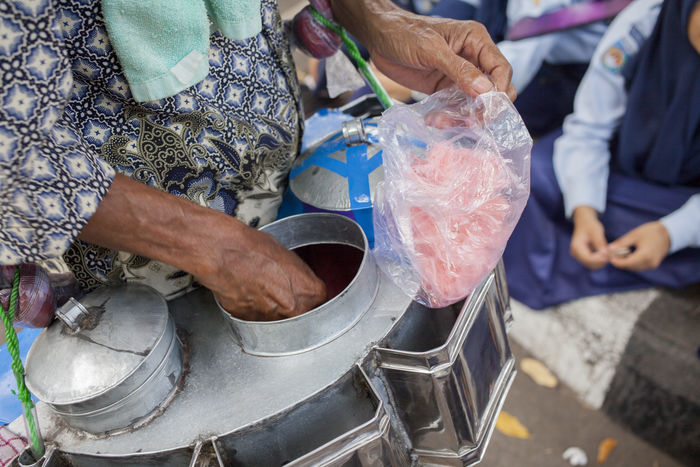 cotton candy City Life Old Man After School Cotton Candy Dealer Food Food And Drink Hands In The Street INDONESIA Market Retailers Storytelling Street Food Street Market Sweet Food Traveling Travelphotography