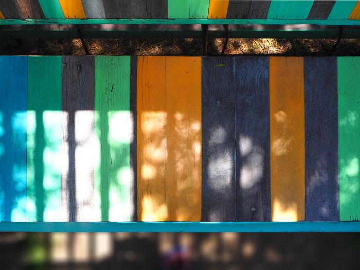 Sunlight Falling On Wooden Bench