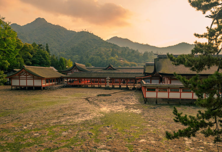 Japan Japan Photography Miyajima Architecture Beauty In Nature Building Exterior Built Structure Day Hiroshima Landscape Mountain Mountain Range Nature No People Outdoors Scenics Sky Sunset Tree Water
