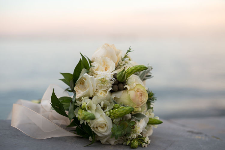 Abandoned Bouquet of Flowers by the Sea Beach Beauty In Nature Boquet Of Flowers Bouquet Bride Celebration Celebration Event Ceremony Close-up Flower Flower Arrangement Flower Head Flowers Focus On Foreground Freshness Life Events Outdoors Ribbon - Sewing Item Sea Seaside Sunset Wedding Wedding Ceremony Wedding Dress