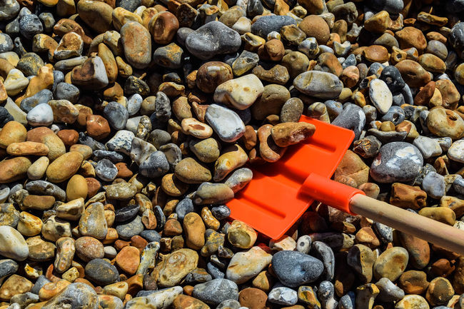 At The Beach Beach Photography Close-up Colorful Colourful Day No People On The Beach Outdoors Pebble Pebble Beach Pebbles Red Shoveler Red Spade