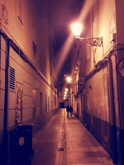 Illuminated street lights in city at night
