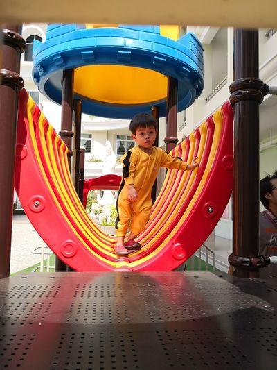 Portrait of boy in amusement park
