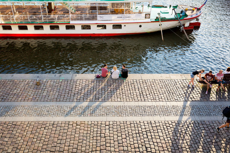 Lengthening Shadows Czech Friends People Watching Prague Shadow And Light Sigma Summertime Sunlight Sunny The Street Photographer - 2018 EyeEm Awards Boat Candid Canon Canonphotography Cobblestone Evening People Shadow Sigma 35mm Art Street Streetphotography Summer Sun Sunset Water