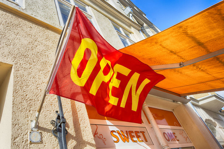 Architecture Building Exterior Built Structure Day Low Angle View Multi Colored No People Open Sign Outdoors Shop Sign Sky Text