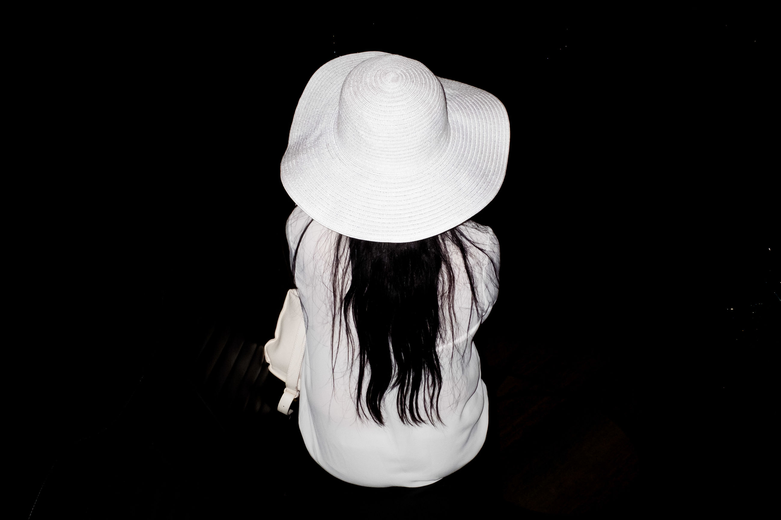 hat, real people, black background, sun hat, women, one person, indoors, lifestyles, night, close-up, people