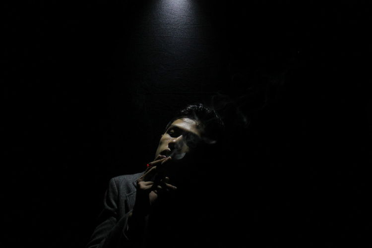 Midsection of man against black background