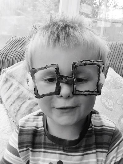 Sunglasses Childhood Front View Real People Looking At Camera Eyeglasses  Portrait One Person Boys Elementary Age Leisure Activity Day Glasses Indoors  Headshot Lifestyles Home Interior Close-up Smiling People