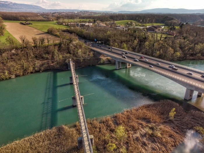Passerelle de Chèvre at Bernex, Switzerland 🇨🇭 2019 Bridge DJI X Eyeem DJI Mavic Air Drone Photograph Swiss Switzerland Rhône Water High Angle View Nature No People Day Tree Scenics - Nature Architecture Built Structure Tranquil Scene Environment Beauty In Nature Mountain Outdoors Plant Tranquility Landscape Flowing Water River Non-urban Scene