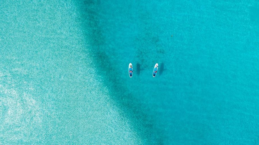 Stand Up Paddling. Sup High Angle View Water Nature Sport Turquoise Colored Holiday Aerial View Sea Vacations Lifestyles Day People Leisure Activity Group Of People Trip Travel My Best Photo