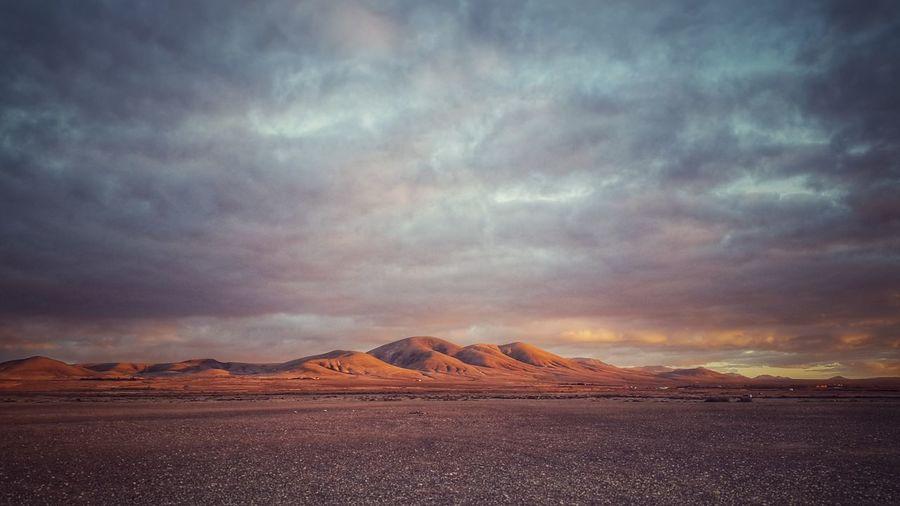 Scenic View Of Dramatic Sky Over Desert