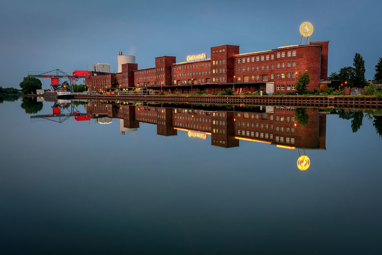 Conti Stöcken in Hannover am Mittellandkanal Water Reflection Waterfront Architecture Built Structure Lake Sky Building Exterior Nature Symmetry Clear Sky Standing Water Building Outdoors Moon Travel Destinations Travel Architecture Industry Industrial Canal Hannover Long Exposure Reflection EyeEmNewHere